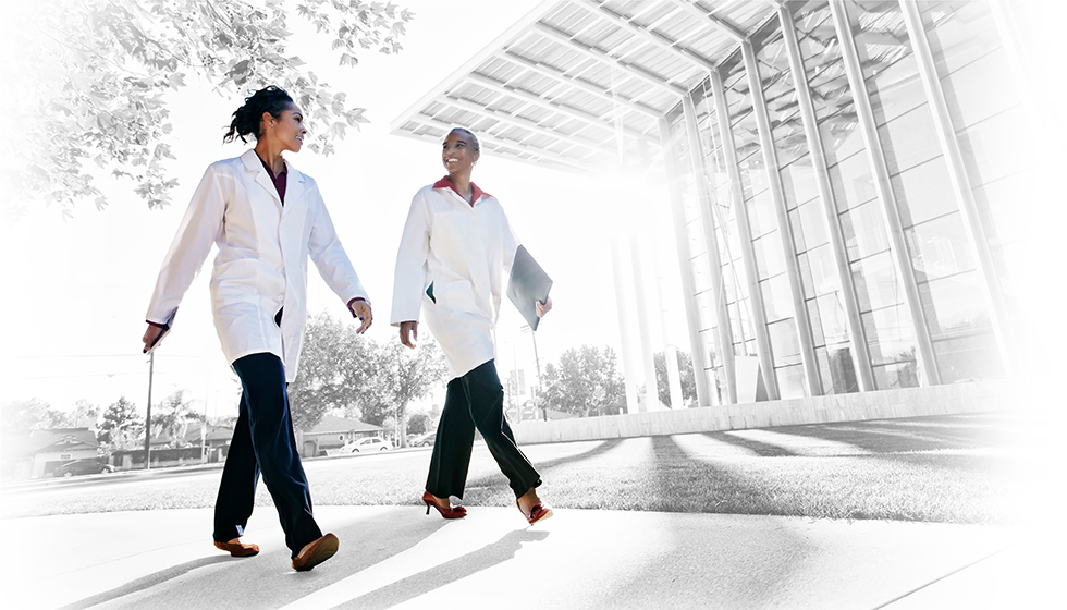 2 physicians walking